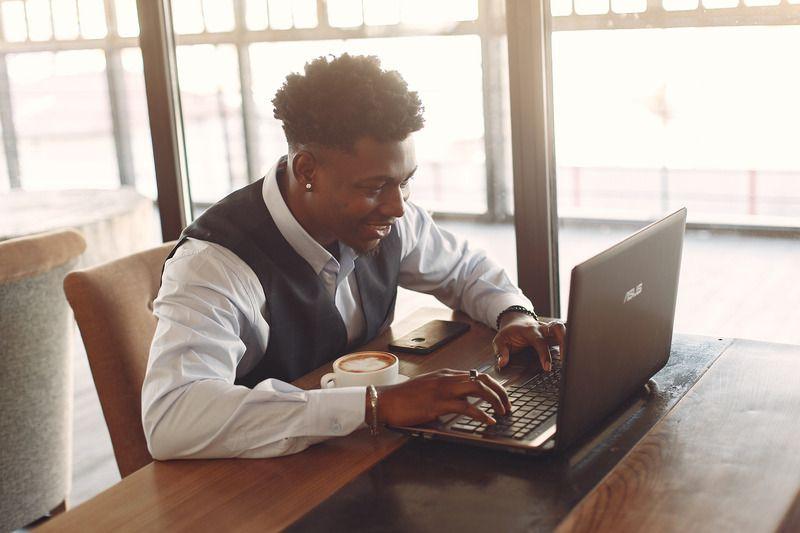 man on laptop planning virtual event