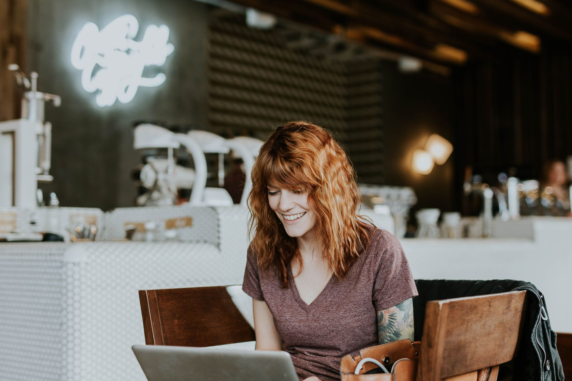 woman looking at laptop and smiling